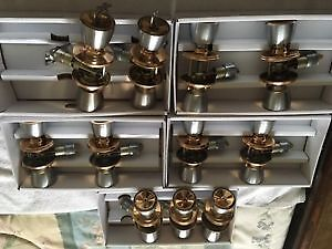 11 Door Handles & 2 Weiser dead bolt with key