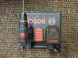 Hammer drill Bosch. Two lithium battery 18v. Charger. Hard case.