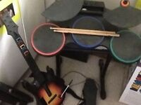 Wii drums & foot pedal and air guitar with drum sticks and 5 games, all gwo