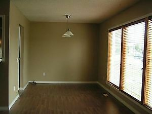 3 bedroom main floor/Garage/$1250.00 plus 50% utilities/Sept 1