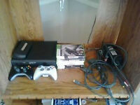 120 GB Xbox 360 For sale with 9 games included and 2 controllers