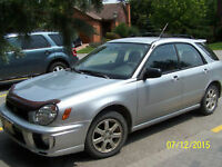 2003 Subaru Impreza 5 speed manual. roof racks Sedan