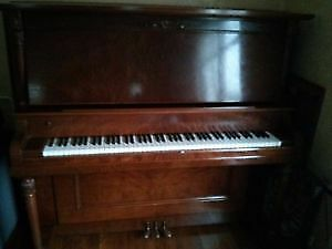 Beautiful upright piano – immaculate condition