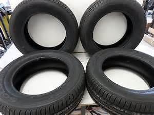 TIRES FOR SALE..CLEANING OUT MY GARAGE..LOTS OF TREAD.