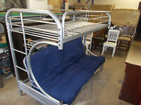 Grey metal bunkbed with fouton on the bottom and a single bed on