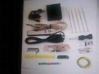 Complete tattoo kit, all brand new never used.  1 tattoo gun  1