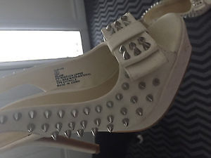 *** Spiked white sexy heels ***