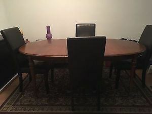 Wooden table with two leafs & 6 faux dark brown leather chairs