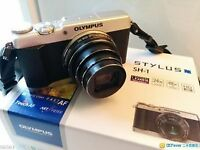 OLYMPUS STYLUS SH1 + UNIVERSAL BATTERY CHARGER