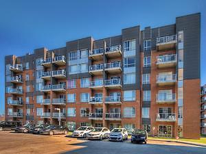 Lachenaie: Unité de style loft. Construction 2012!!!