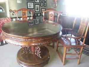 Round, glass solid wood dining table or hall entry table.