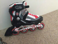 white, red and black Schwinn size 6 Rollerblades for only $35.