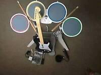 Wii Rockband, drums, guitar, mic plus Lego Rockband discs x 2