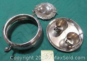 Silver plated : casserole holder, candy dish with handle, cream and sugar on tray