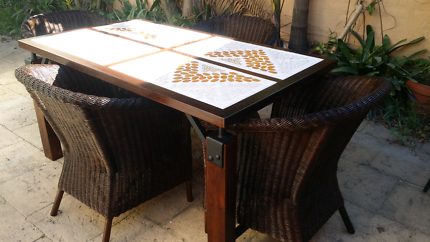 Outdoor mosaic table with 4 wicker chairs