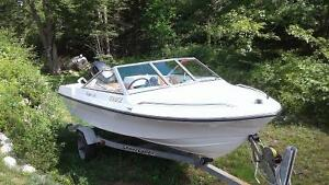Cadorette motorboat with 75 hp outboard and trailer