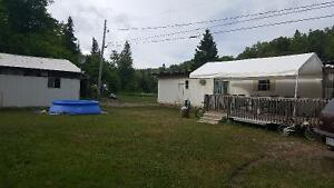DOUBLE WIDE MOBILE HOME WITH LARGE WIRED GARAGE $25,000..