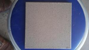 unopen boxs of tiles 2x2 inch have a rough glay like finsh