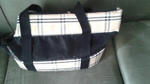 Dog carrier and bowl.  Brand new.