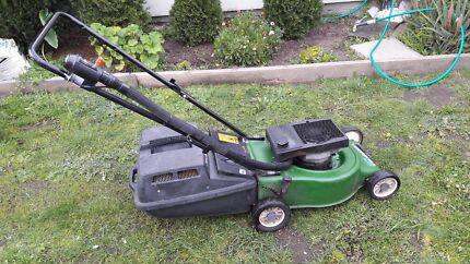 """VICTA lawn mowr 4 HP 2 stroke engine 18""""  2 blade cutting system"""