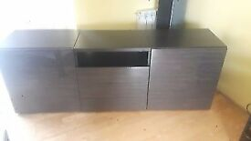 Ikea shelfs unit with black glass panel on the top