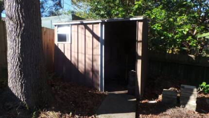 Garden shed, brown colourbond, old but sturdy