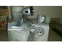 TWO CHROME SPOT LIGHTS. NEW. NEVER USED. IN BOXES
