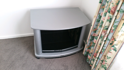 TV cabinet on wheels with swivel top and glass doors