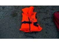 Children's life jackets, Marinepool 20-30kg and a Harveys 10-20kg with whistles, never used.