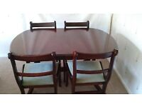 Quality mahogany coloured Dining Table & 4 upholstered chairs
