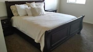Europa collection mahogany sleigh bed and night stands.