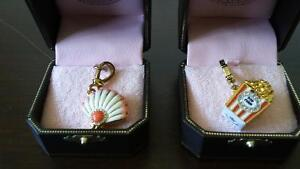 Juicy Couture Popcorn and oyster charms.