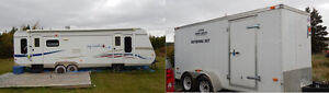 Camper and a utility cargo trailer