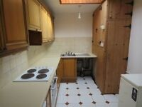 Used kitchen complete with fridge and cooker.