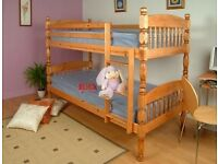 A AMERICAN PINE BUNKBED WITH MATTRESS/CONVERTS INTO TWO SINGLE BEDS