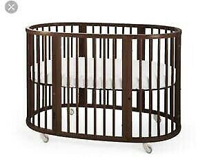 Stokke cot in walnut with bassinet and larger cot