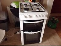 White bush gas cooker with gas pipe in good condition