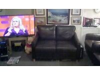 Two seat Italian leather sofa in excellent unmarked pristine as new condition