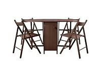 Oval space saving table and four chairs