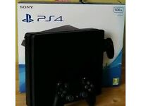 SONY PLAYSTATION 4 SLIM IN BOX - Comes with Fifa and a good condition controller