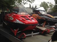 2 snowmobiles and 4 place trailer