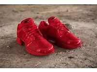 Pair of Red Adidas Climacools