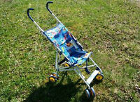 Blue fabric with jungle animals - Kolcraft umbrella stroller