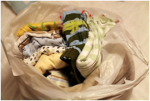 Fill a Bag with Up to 30 Baby Clothes for Only $7.00