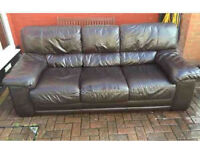 Leather three seat sofa with matching armchair