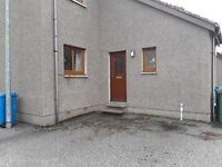 Ground floor two bed flat near town centre, private parking, close to all amenities