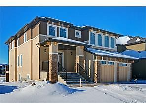 CHESTERMERE KINNIBURGH LUXURY WITH A HUGE SUNNY LOT