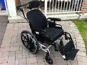 Tilting Wheelchair with special air cushion (roho) to prevent be