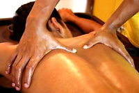 Indian male, offering full body oil massage on massage table