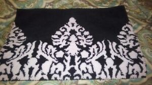 Torn Black and White Area Rug
